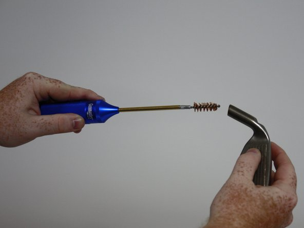 Use a wire  brush to clean out the remains of the old epoxy from the club head.