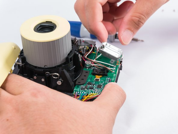 With a solder kit, heat the connecting solder points to open the connection, thus removing the connecting wires. There are many ways to do this, depending on the available tools on hand.