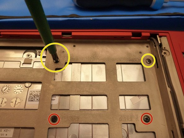 Keyboard screws are marked with red circles.