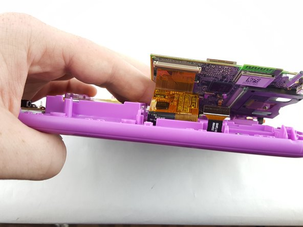 Image 3/3: The device was rotated 180 degrees in order to unplug the display assembly cord.