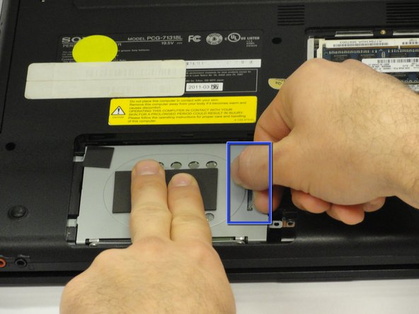 Image 1/1: Hold the hard drive securely in a horizontal position using your other hand.