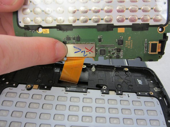 Carefully unclip the silver metallic tab from the motherboard.