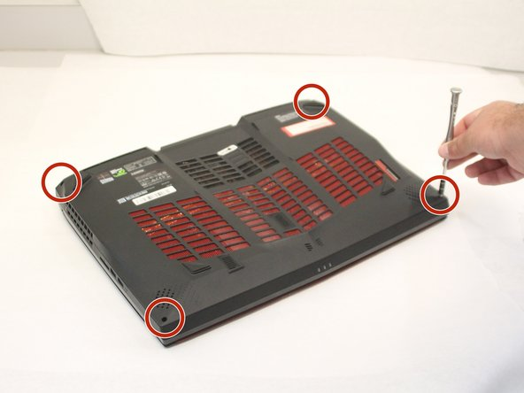 Remove the four rear screws using the Phillips #0 screwdriver from the laptop as shown. The screws are 0.5 inches long.
