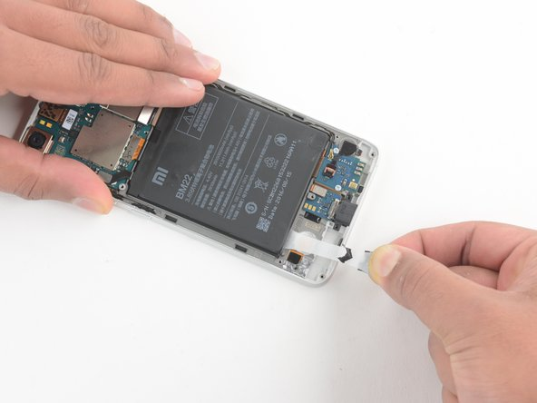 The battery is held in with adhesive pull tabs.
