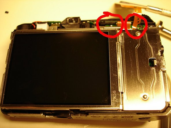 Repairing Canon Powershot Camera indicates low battery and shuts down