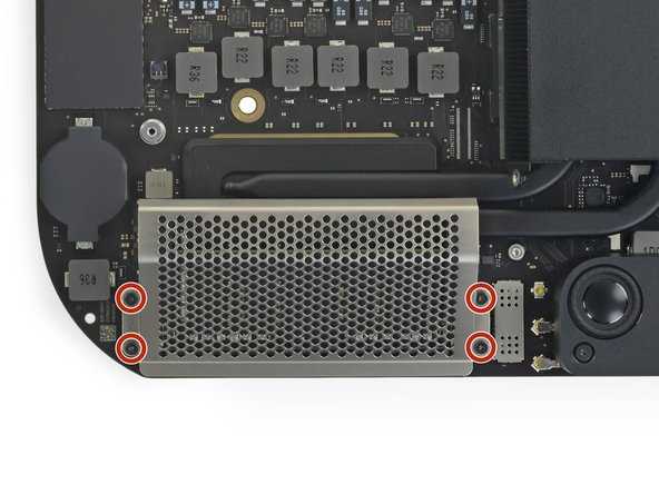 Use a T5 Torx driver to remove the four 2.8 mm screws securing the RAM shield.