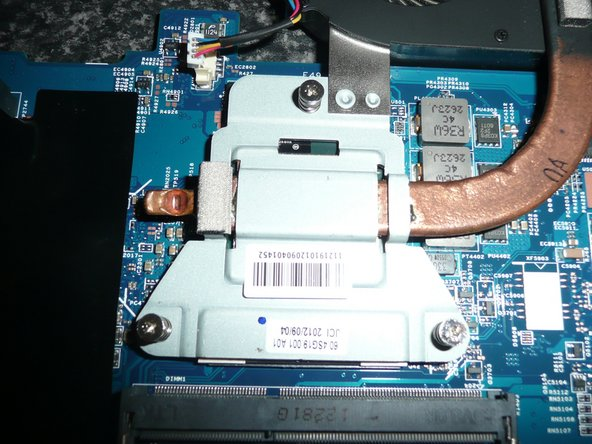 Use some isopropyll to remove the old Thermal Grease/Compound from the heat sink.