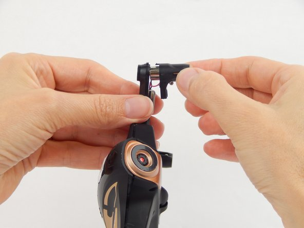 Hold the base of the arm while gently pulling the motor cover away from the arm.