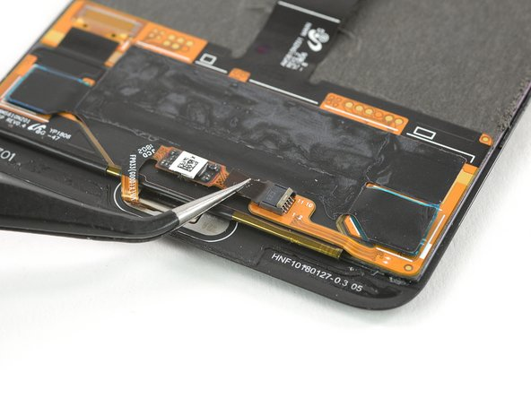 Use a pair of tweezers to gently pull the home button flex cable out of its ZIF connector.