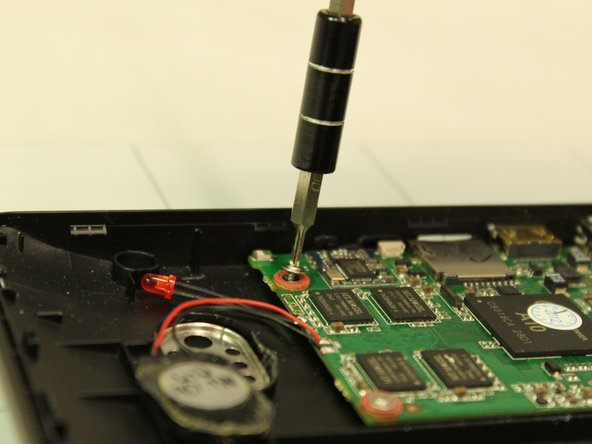 Use the Phillips 1.5 mm screwdriver (Phillips #000) to unscrew the green motherboard from the body at the three points