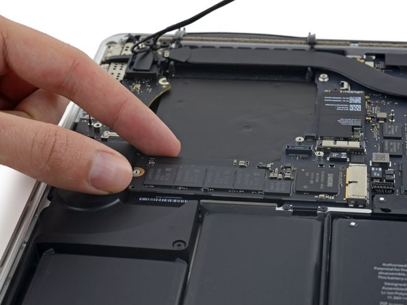 Image 1/3: Do not lift the SSD too high, or you could damage the contacts or socket.