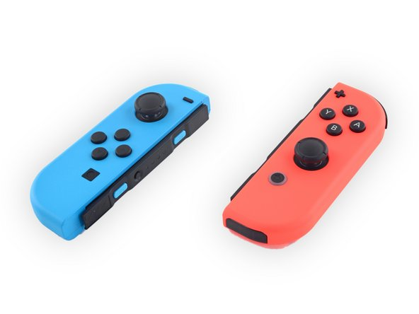 Image 1/3: With different contents come different model numbers: The neon blue controller is designated HAC-015, while the neon red is HAC-016.