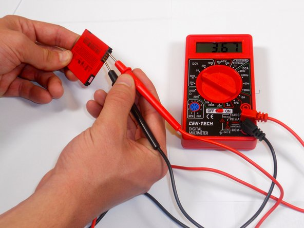 Image 1/2: Put the black lead into ground slot of multimeter and the red lead into the V(ohm)mA slot.