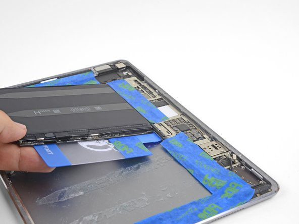 The goal is to lift the battery contacts high enough such that they clear the screw post underneath the logic board.