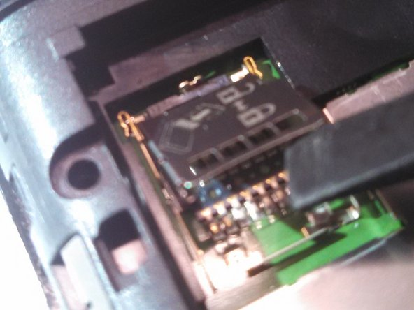 The SD card slot can be opened and closed, as depicted by the tool.