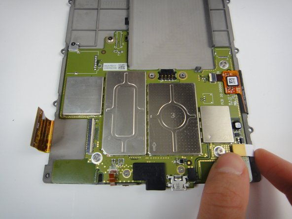 Lift up the flat, yellow connector from its socket on the bottom right of the motherboard.