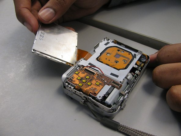 Image 3/3: The casing may possibly be attached to LCD screen. If so, leave attached to screen.