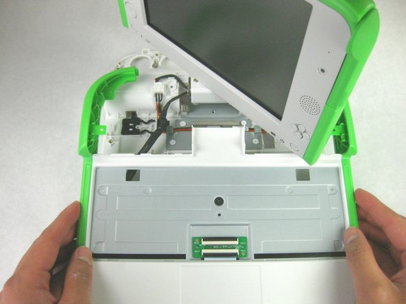 There may be some adhesive holding the cable to the metal plate. Gently pull the cable off of the plate if it is stuck.