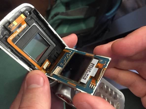 Use your fingers to remove the screen and unplug the ribbon cable from the bottom right corner of the back of the screen.
