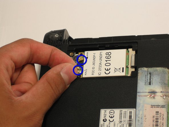 Image 1/1: Disconnect the two antenna wires attached to the left side of the wireless card.