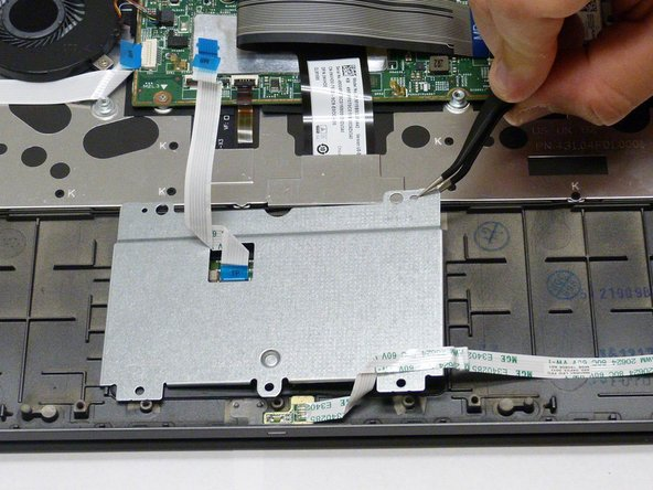 Once the ribbon cable is disconnected lift up on the back cove to remove it and expose the mouse pad.
