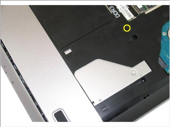 Remove the screw that secures the optical drive to the computer.