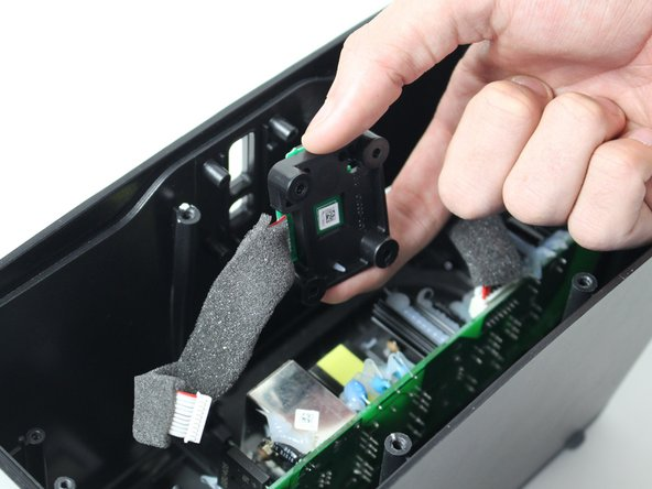 Gently pull the button board toward you and then remove from the case.