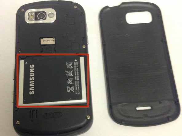 Remove the battery from the phone by pulling up on the battery edge.