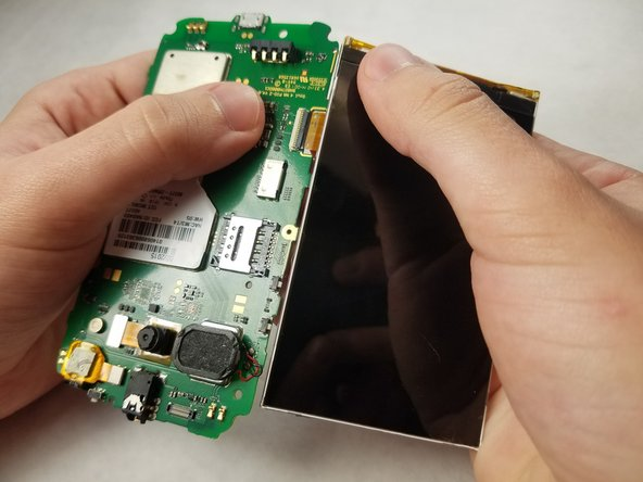 Carefully separate the digitizer from circuit board.