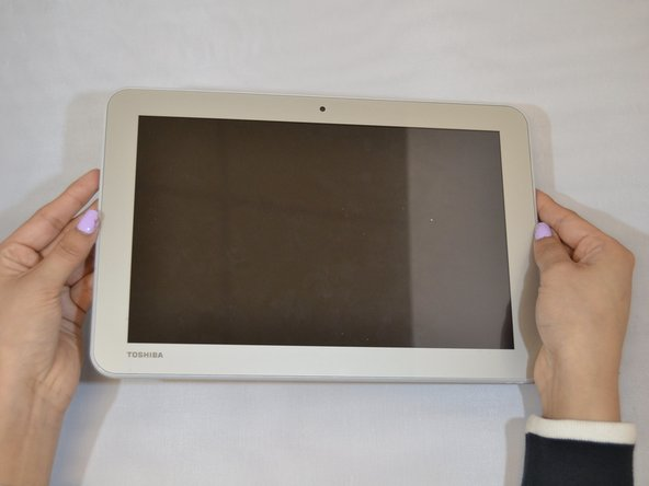 Start by holding your Toshiba tablet faced up.