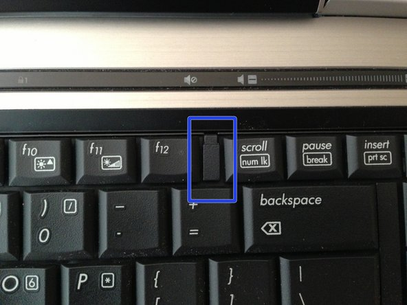 Slide the retention clips toward the keyboard to release the keyboard