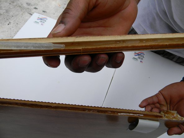 Run a thick bead of epoxy on the inside rim of the smaller piece of cabinet door.