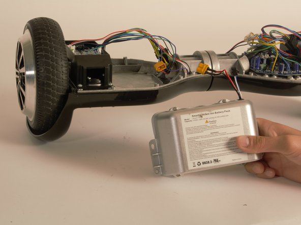 Image 2/3: The battery should be completely removed from the hoverboard.