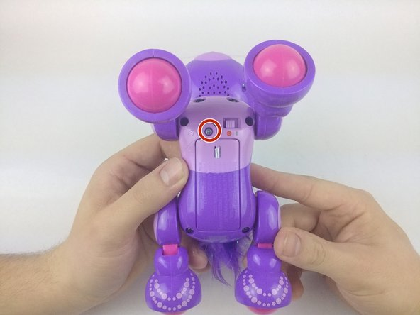 Turn the Zoomer Meowzies over so it is on its back and its stomach is facing up.