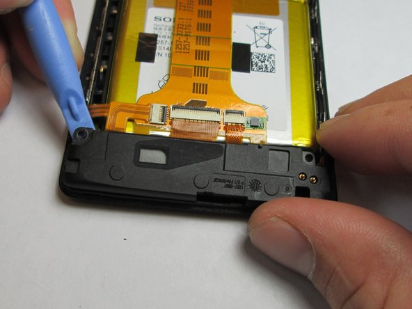Use the plastic opening tool to remove the loud speaker module.