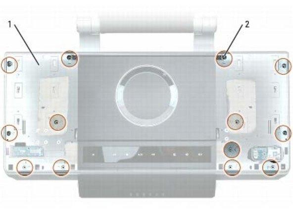 Desatornille los seis tornillos M2.5 x 5 mm en el lado izquierdo (# 1) de la cubierta superior, luego desenrosque los siete tornillos M2.5 x 5 mm en el lado derecho (# 2) de la cubierta superior.