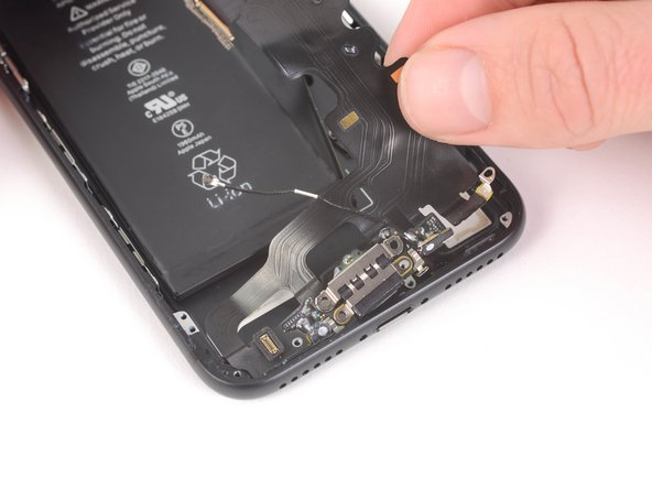 Gently pull the lightning connector out of its hole on the rear case.