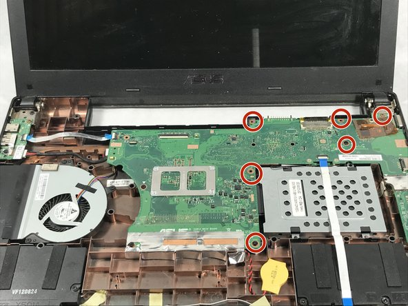 Unscrew the six screws that hold the motherboard to the bottom of the laptop using a Phillips #00 screwdriver.