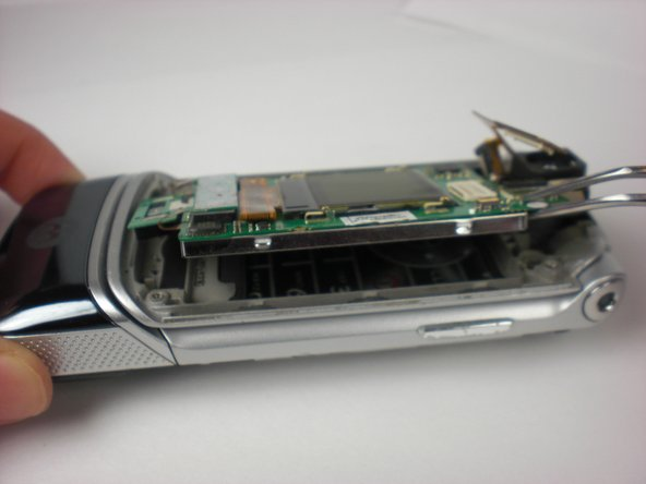 Once the flex cable has been unplugged, use a tweezer to remove the logic board by prying up.