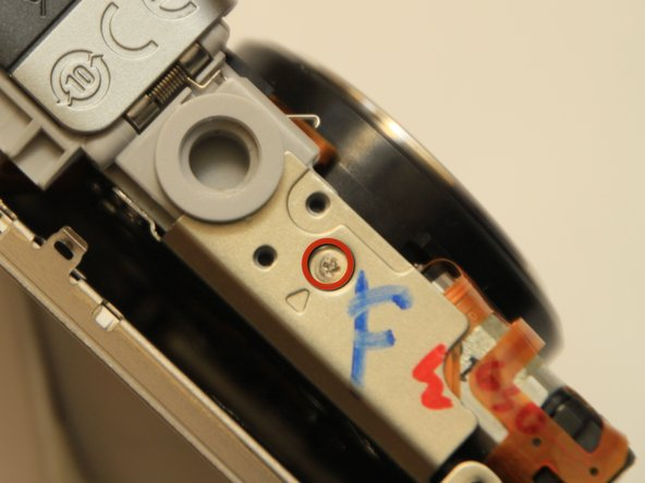 Remove the coarse thread screw holding the battery compartment to the bottom of the main camera bracket.