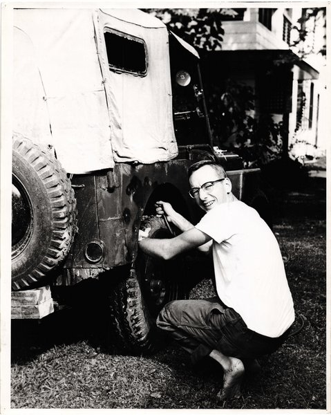 My dad fixing an old Jeep way back when.