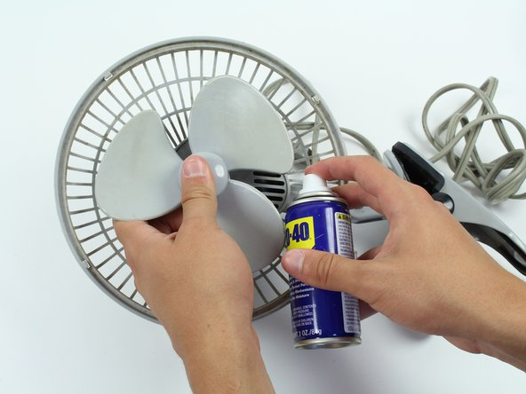 If the fan blade axle has any hair or dirt, then clean it with a cloth to avoid further fan blade blockage.