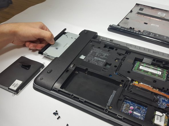 The DVD/CD drive will be extended from the side of the laptop. Slowly remove it from the computer.
