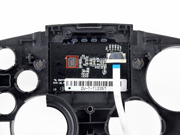 "Image 2/2: Strapped to the back of a 0.9"" x 1.5"" touchpad is a MA32P03 touchpad controller, providing 2D mouse tracking for the Ouya."