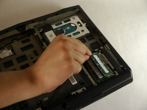 Grab and pull the RAM sticks up and out of their casing and set them aside.