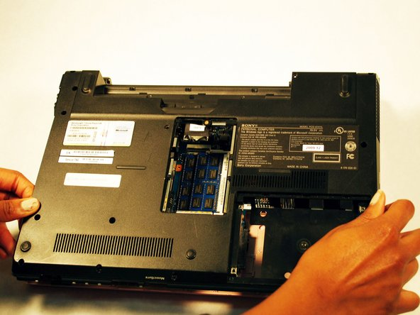 Gently lift the panel up to remove it once all the screws have been removed.