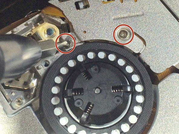 Remove the two 2.8mm Phillips screws pictured.