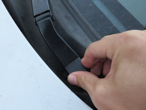 Image 2/3: Once the wiper cap is secure, you may repeat steps 1-9 to the other wiper arm.