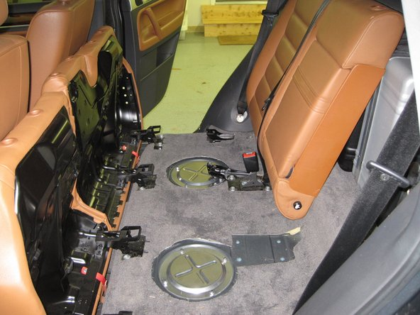Use a 10mm triple square driver to remove the 4 bolts on the seatback bracket.