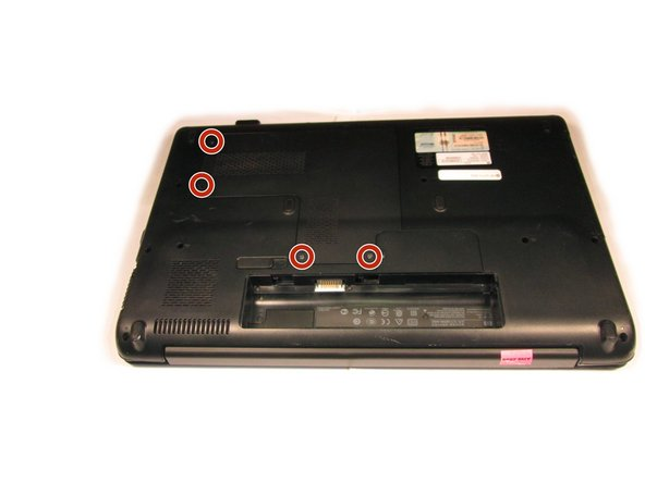 The access panel to the hard drive and RAM is held in place by four  screws. Loosen them using a Phillips #0 screwdriver.